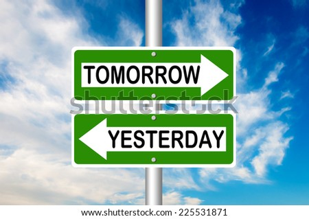 Tomorrow and Yesterday road signs - stock photo