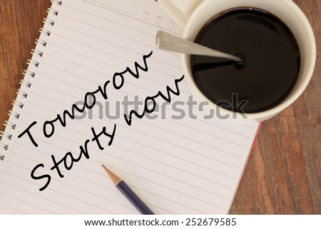 Tomorrow Starts Now Concept with coffee cup - stock photo