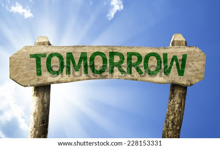 Tomorrow wooden sign on a beautiful day - stock photo