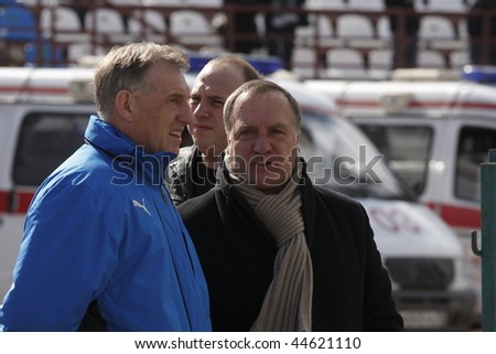 "TOMSK, RUSSIA - APRIL 5: Dirk Nicolaas ""Dick"" Advocaat (right) is a Dutch football former player and current coach of the Belgian national football team and AZ Alkmaar, April 5, 2008 in Tomsk, Russia - stock photo"
