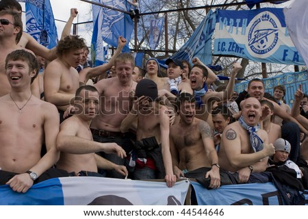 TOMSK, RUSSIA - APRIL 5:Football Club Zenit fans cheer their team at the match Championship of Russia among Tom'(Tomsk) - Zenit (Spb), April 5, 2009 in Tomsk, Russia. - stock photo