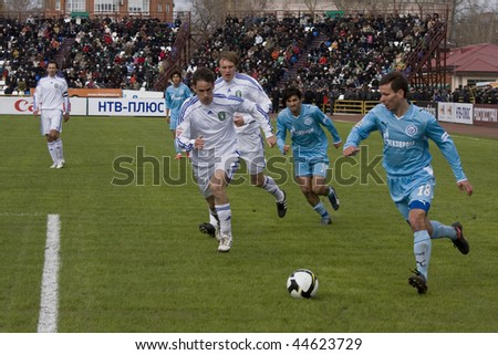 TOMSK, RUSSIA - APRIL 5: Football match Championship of Russia among Tom'(Tomsk) - Zenit (St.Petersburg), April 5, 2009 in Tomsk, Russia. - stock photo