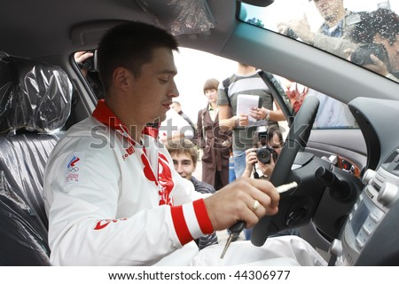 TOMSK, RUSSIA - AUGUST 28:Anton Golotsutskov-gymnast, Olympic Champion 2008,five-time European champion in-car Toyota Camry given him the governor of Tomsk region, August 28, 2008 in Tomsk, Russia