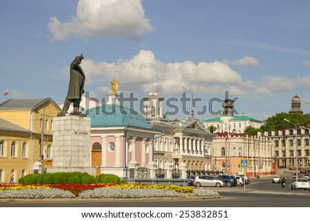 Tomsk, Russia - August 16, 2014: Lenin Statue in Tomsk, stands as a reminder of its Soviet past, a vast brooding statue of Lenin still glowers over a city centre that has already lost much of its - stock photo
