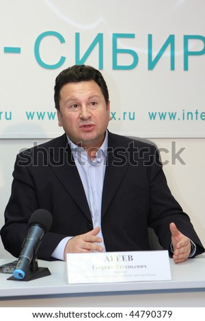 TOMSK, RUSSIA - DEC 4: George Ageev - Director of the National Philharmonic Orchestra of Russia at a press conference in agency Interfax-Siberia, December 4, 2009 in Tomsk, Russia. - stock photo