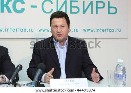 TOMSK, RUSSIA - December 4: George Ageev - Director of the National Philharmonic Orchestra of Russia at a press conference in agency Interfax-Siberia, December 4, 2009 in Tomsk, Russia. - stock photo