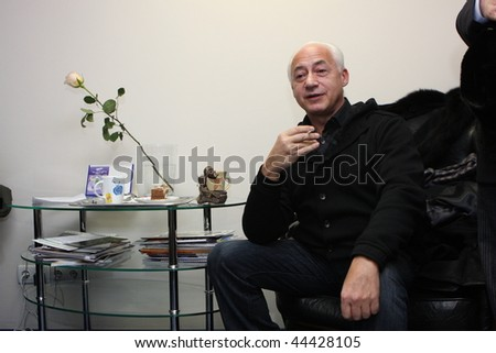 TOMSK, RUSSIA - DECEMBER 4: Vladimir Spivakov - artistic director and chief conductor of the National Philharmonic Orchestra of Russia in agency Interfax-Siberia, December 4, 2009 in Tomsk, Russia. - stock photo