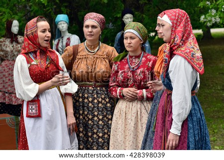 TOMSK, RUSSIA - MAY 28, 2016: Dressed in Russian national costumes artists perform on the Siberian folklore exhibition