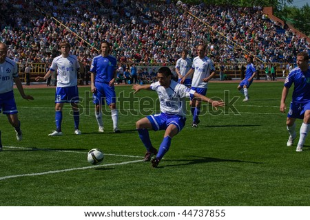 TOMSK, RUSSIA - MAY 30: Football match Championship of Russia among Tom'(Tomsk) - Dinamo (Moscow), May 30, 2009 in Tomsk, Russia. - stock photo