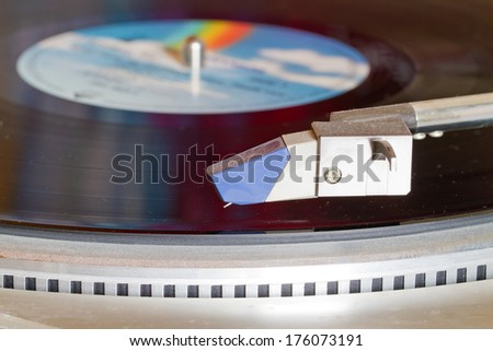 Tone arm of a old record player - stock photo
