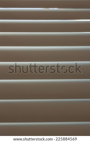 Toned aluminum blinds in the closed position shot closeup