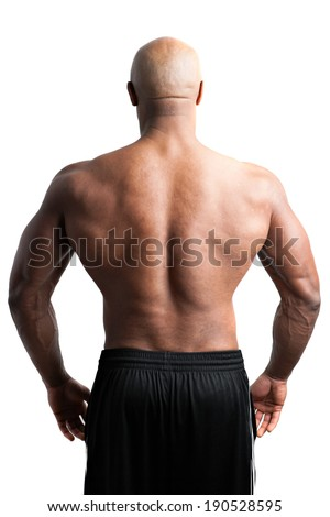 Toned and ripped body builder with a muscular back. - stock photo