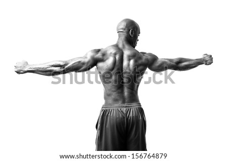 Toned and ripped lean muscle fitness man isolated over a white background in high contrast black and white. - stock photo