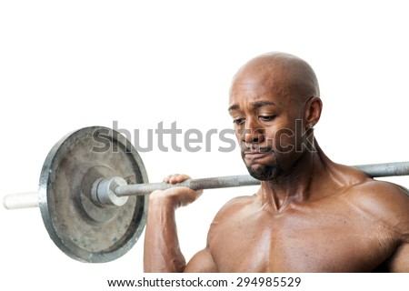 Toned and ripped lean muscle fitness man lifting weights isolated over a white background. - stock photo