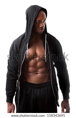 Toned and ripped lean muscle fitness man wearing a hooded sweatshirt isolated over a white background. - stock photo