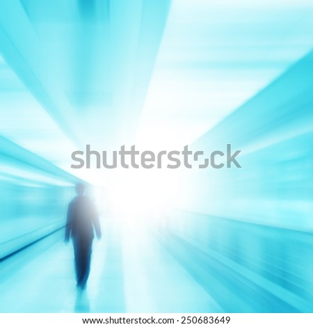 Toned blurred image of blurred man walking to light.  - stock photo