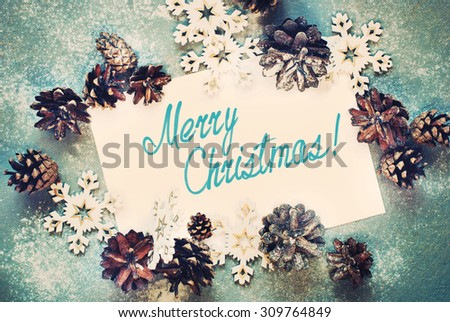 Toned Card with Decorative Snowflakes and Pine cones, Message Merry Christmas on the letter, isolated on white - stock photo