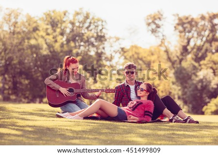Toned. Closeup picture of best friends making selfie on mobile or smart phone while spending their free time on picnic. - stock photo