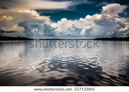 Toned color landscape of the river and clouds i the Amazon River, Iquitos, peru.  - stock photo