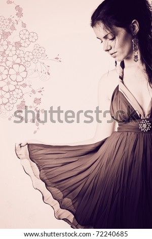 Toned image of a beautiful girl with dress smiling