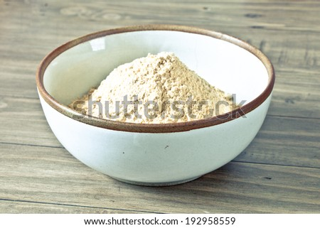 Toned image of a bowl of flour for making dough