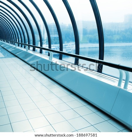 Toned image of empty glazed corridor. - stock photo