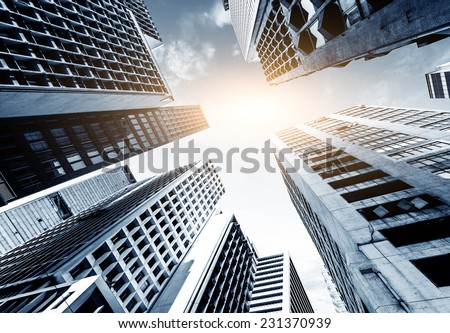 Toned image of modern office buildings in central Hong Kong. - stock photo