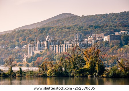 Toned image of West Point taken from across the river on a hazy morning. - stock photo