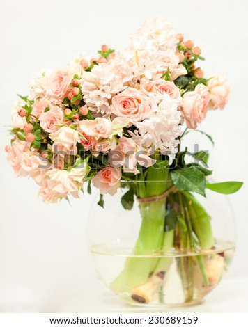 Toned photo of beautiful fresh pink flowers in glass vase - stock photo