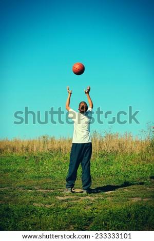 Toned photo of boy basketball training - stock photo