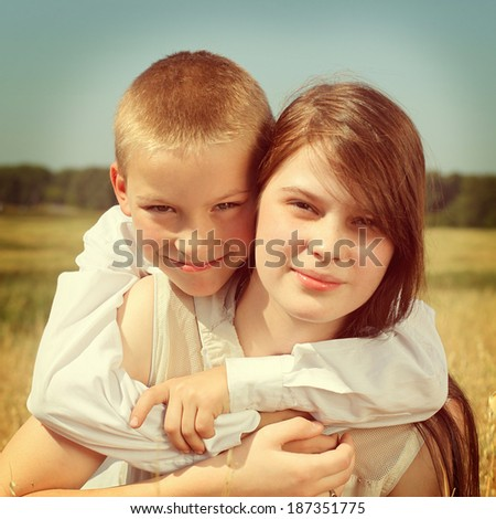 Toned photo of Brother and Sister outdoor - stock photo