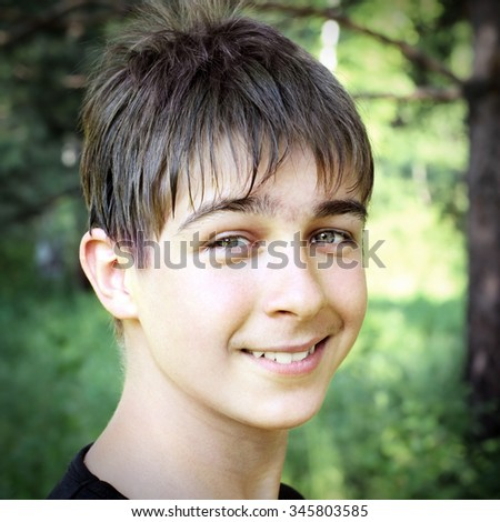 Toned Photo of Cheerful Teenage Boy Portrait outdoor - stock photo