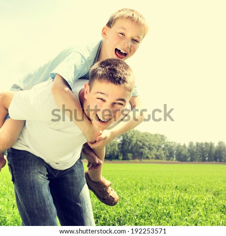 Toned photo of Happy Brothers at the Summer Field - stock photo