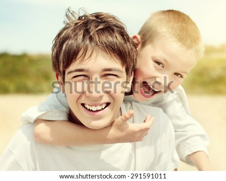 Toned Photo of Happy Teenager and Kid Portrait outdoor