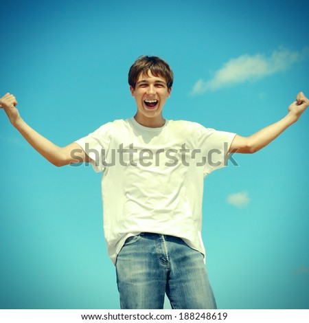 Toned photo of Happy Teenager on the Blue Sky Background - stock photo