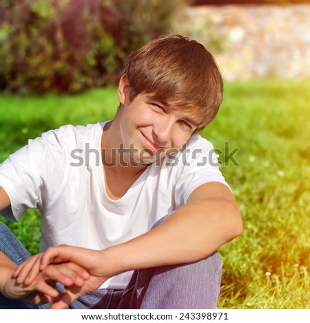 Toned Photo of Happy Teenager on the Grass - stock photo
