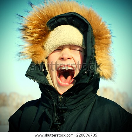 Toned photo of Kid Yell in the Winter - stock photo