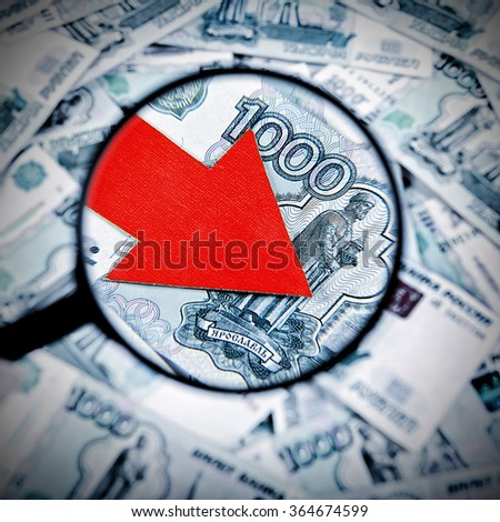 Toned Photo of Magnifying Glass on the Russian Currency with Arrow Down - stock photo