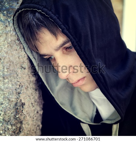Toned Photo of Sad Teenager Portrait by the Wall - stock photo