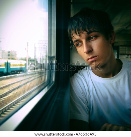Toned Photo of Sad Teenager sit in the Train by the Window