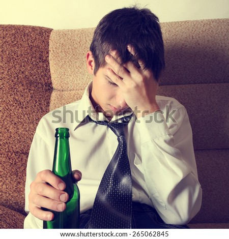 Toned Photo of Sad Teenager with Bottle of the Beer - stock photo