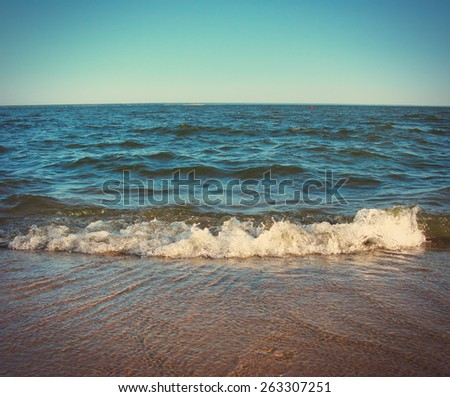 Toned Photo of seaside landscape with coming waves - stock photo