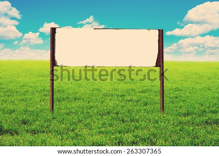 Toned Photo of signboard in the summer filed