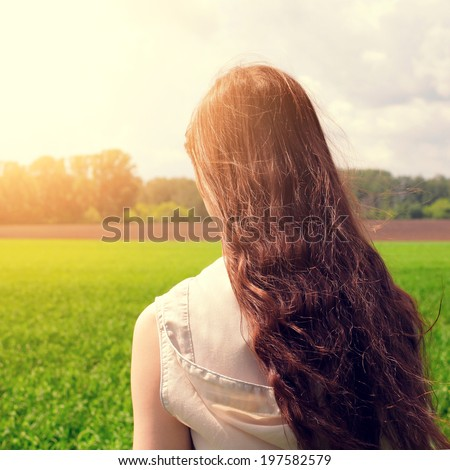 Toned photo of Teenage Girl at the Summer Field - stock photo