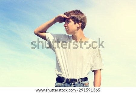 Toned Photo of Teenager looking for Someone outdoor - stock photo