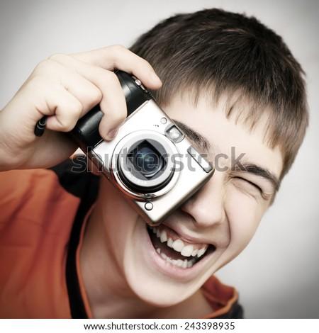Toned Photo of Teenager with Photocamera closeup - stock photo
