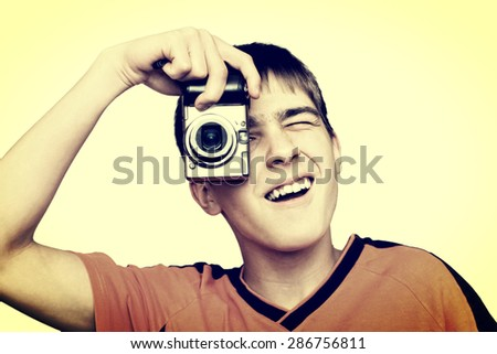 Toned Photo of Teenager with small Photo camera - stock photo