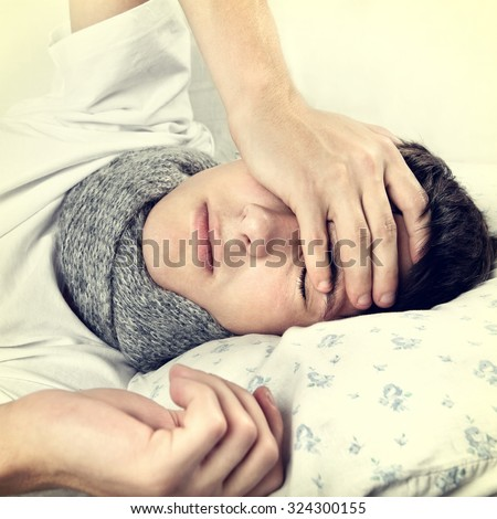 Toned Photo of Young Man sleep on the Bed at the Home