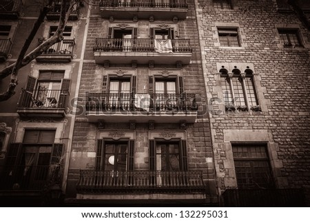 Toned picture of building facade with balconies - stock photo
