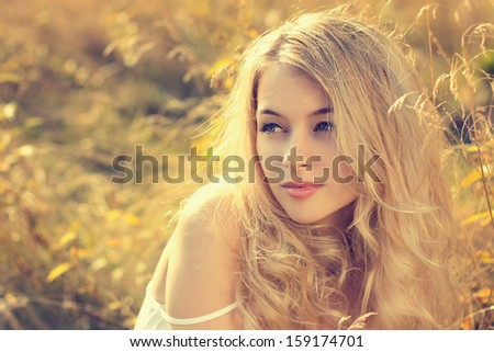 Toned Portrait of Blonde Woman on Nature Background - stock photo